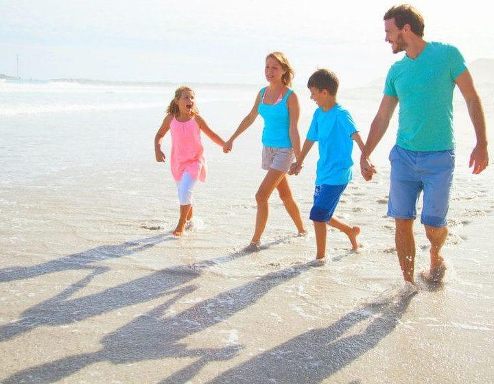 Family of Four enjoying their vacation on St. George Island Beach
