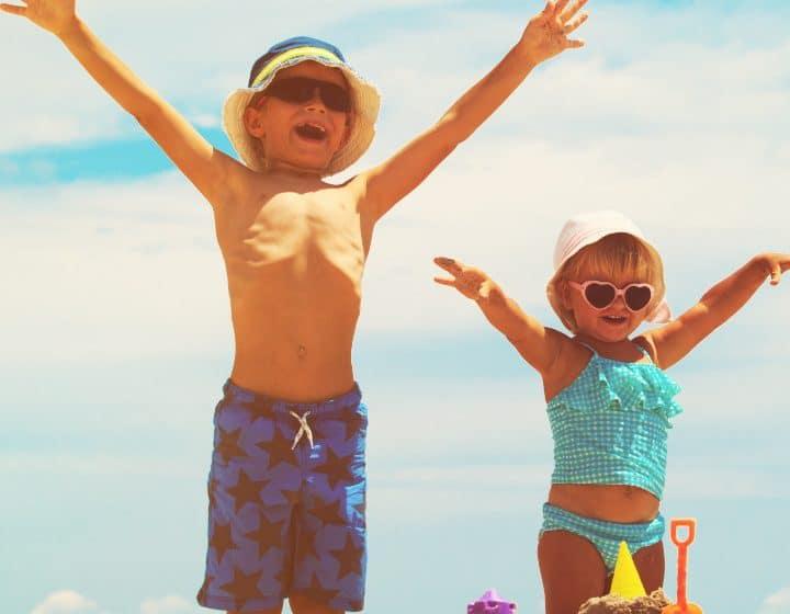 2 kids enjoying building a sand castle on St. George Island Florida