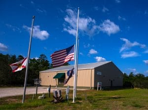 Camp Gordon Johnston WWII Museum in Carrabelle FL with flags at half-staff in honor of 9:11