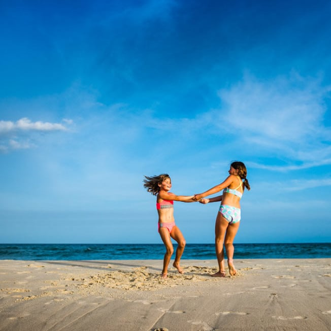 Two girls playing on St. George Island beach