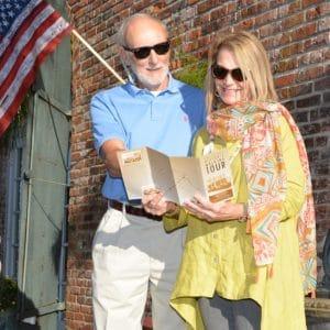 Couple reading walking tour map downtown Apalachicola Florida