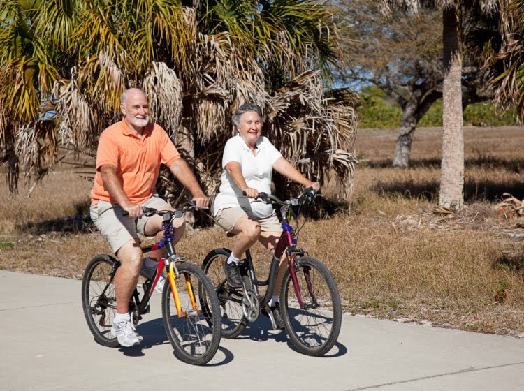 Couple Riding Bikes in St. George Island