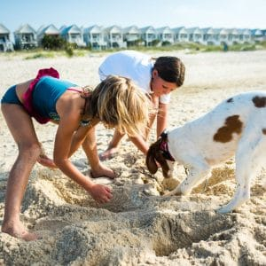 Kids and dog playing on the beach St. George Island FL