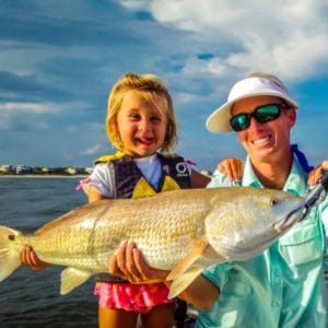Mother and Daughter holding a Red Fish on St. George Island, FL
