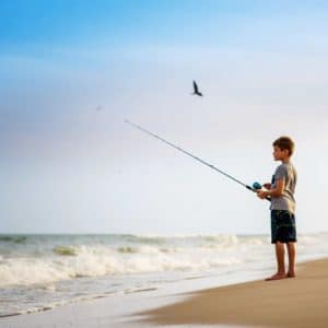 Young Boy Fishing on the Beach on St. George Island Florida