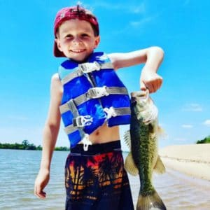 Young Boy holding a Bass on Apalachicola River in Florida