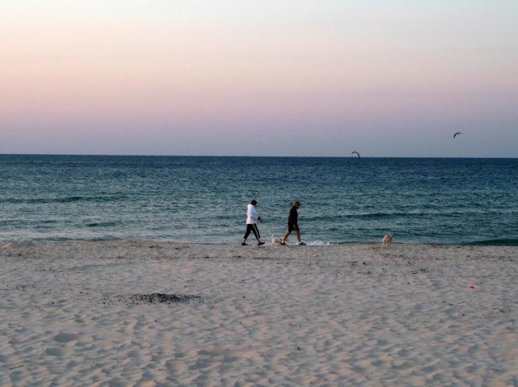 Couple enjoying a walk on the empty beach St. George Island Florida