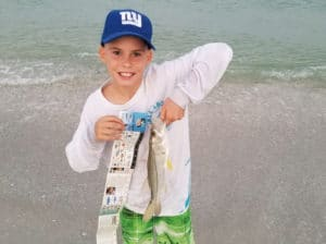 Boy holding a fish
