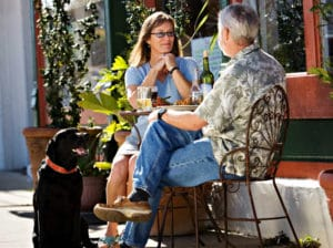 Couple Eating at Pet Friendly Restaurant