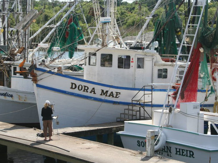 Artist Painting Shrimp Boats in Apalachicola FL