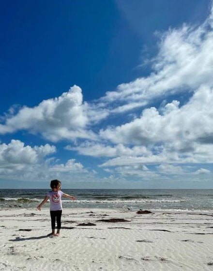 Little girl dancing on the beach at St. George Island FL