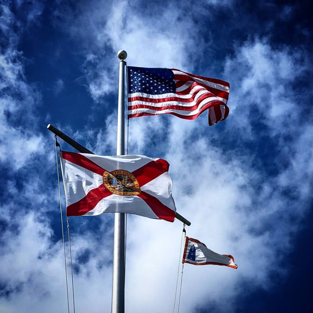 The American Flag with State of Florida Flag below it.