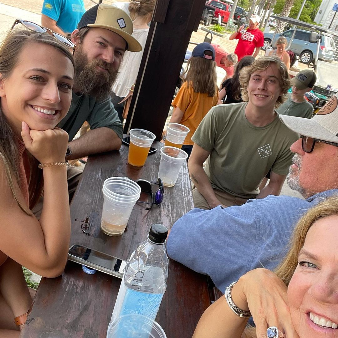 Friends drinking and laughing at Oyster City Brewing Company in Apalachicola FL