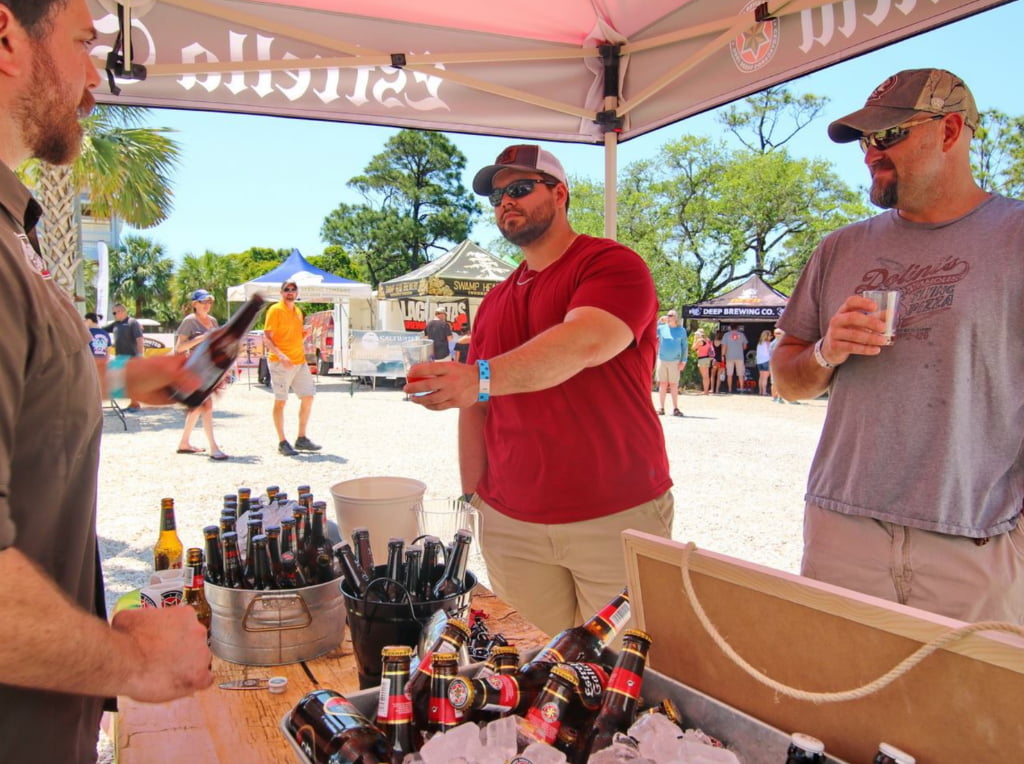 Man receiving beer sample at St. George Island Brewfest.